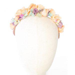 Diadema de flores de tela, pistilos y flor preservada